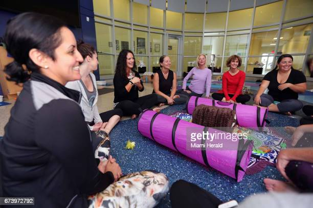 Jessica Almendares left and other participants during the first yoga with cats workshop on Saturday April 22 2017 at Miami Dade Animal Services in...