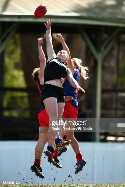 Jessica Anderson of Melbourne Uni contests the ball during the round 14 Women's VFL match between Melbourne University and Diamond Creek at Melbourne...