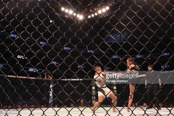 Jessica Andrade fights against Joanna Jedrzejczyk in the Women's Strawweight Title bout during UFC 211 at American Airlines Center on May 13 2017 in...