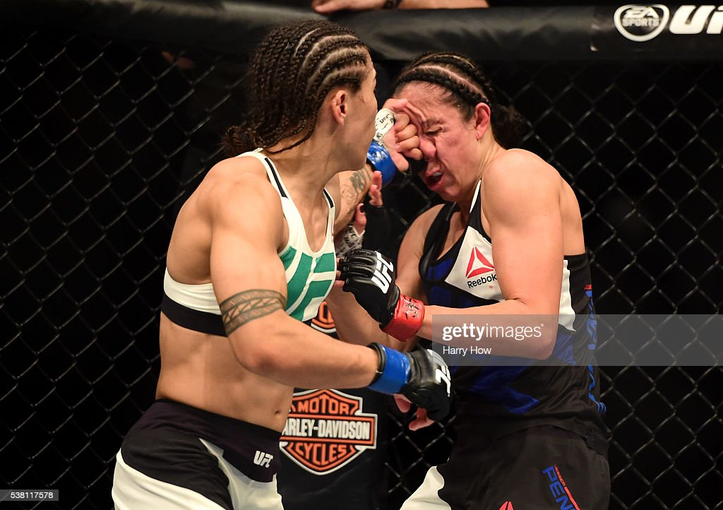 Jessica Andrade lands a left to the face of Jessica Penne in their women's strawweight bout during the UFC 199 event at The Forum on June 4 2016 in...