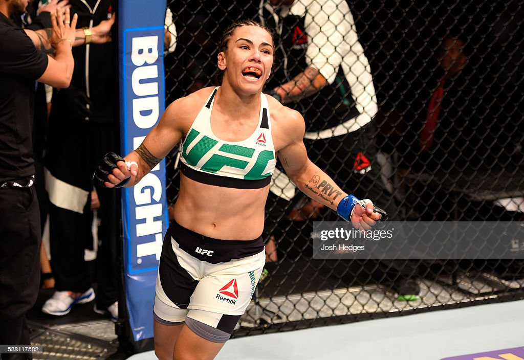 Jessica Andrade of Brazil celebrates her win by TKO in the second round against Jessica Penne in their women's strawweight bout during the UFC 199...