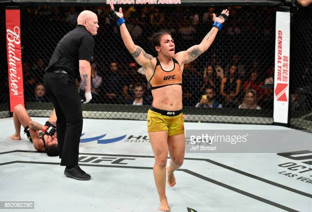 Jessica Andrade of Brazil yells after facing Claudia Gadelha of Brazil in their women's strawweight bout during the UFC Fight Night event inside the...