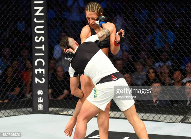 Jessica Andrade punchesJoanna Jedrzejczyk in their UFC women's strawweight championship fight during the UFC 211 event at the American Airlines...