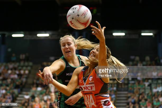 Jessica Anstiss of the Fever and Sarah Wall of the Giants contest for the ball during the round 10 Super Netball match between the Fever and the...
