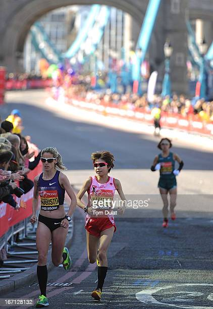 Jessica Augusto of Portugal and Remi Nakazato of Japan pass through Tower Bridge during the Virgin London Marathon 2013 on April 21 2013 in London...