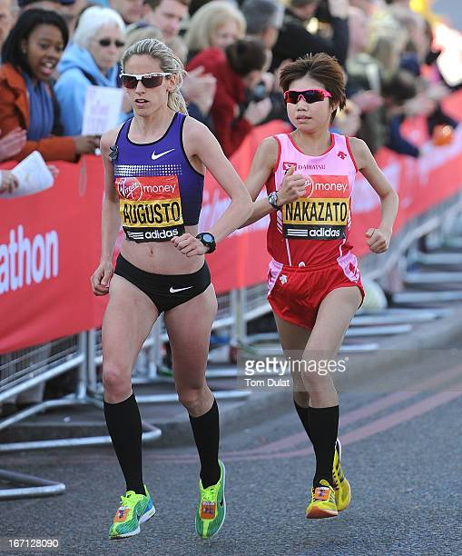 Jessica Augusto of Portugal and Remi Nakazato of Japan run during the Virgin London Marathon 2013 on April 21 2013 in London England