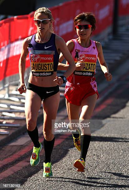 Jessica Augusto of Portugal and Remi Nakazato of Japan run during the Virgin London Marathon on April 21 2013 in London England