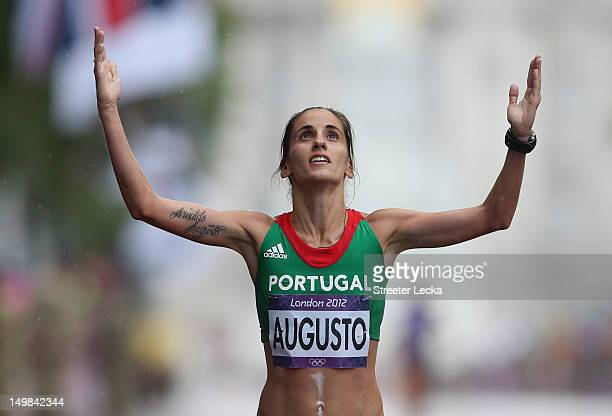 Jessica Augusto of Portugal crosses the finish line during the Women's Marathon on Day 9 of the London 2012 Olympic Games at The Mall on August 5...