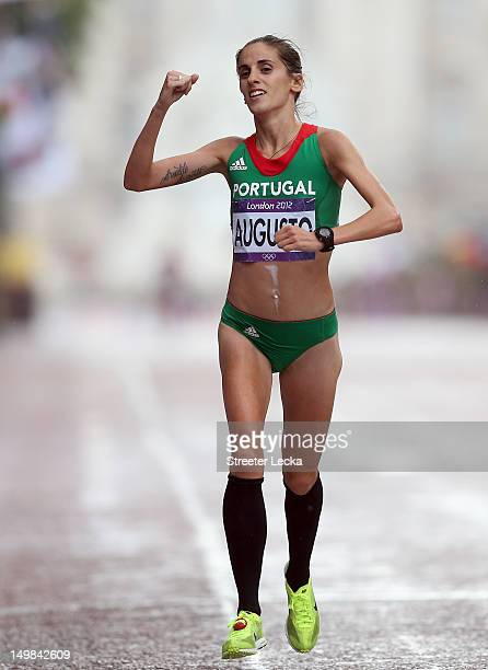 Jessica Augusto of Portugal crosses the finish line during the Women's Marathon on Day 9 of the London 2012 Olympic Games on August 5 2012 in London...