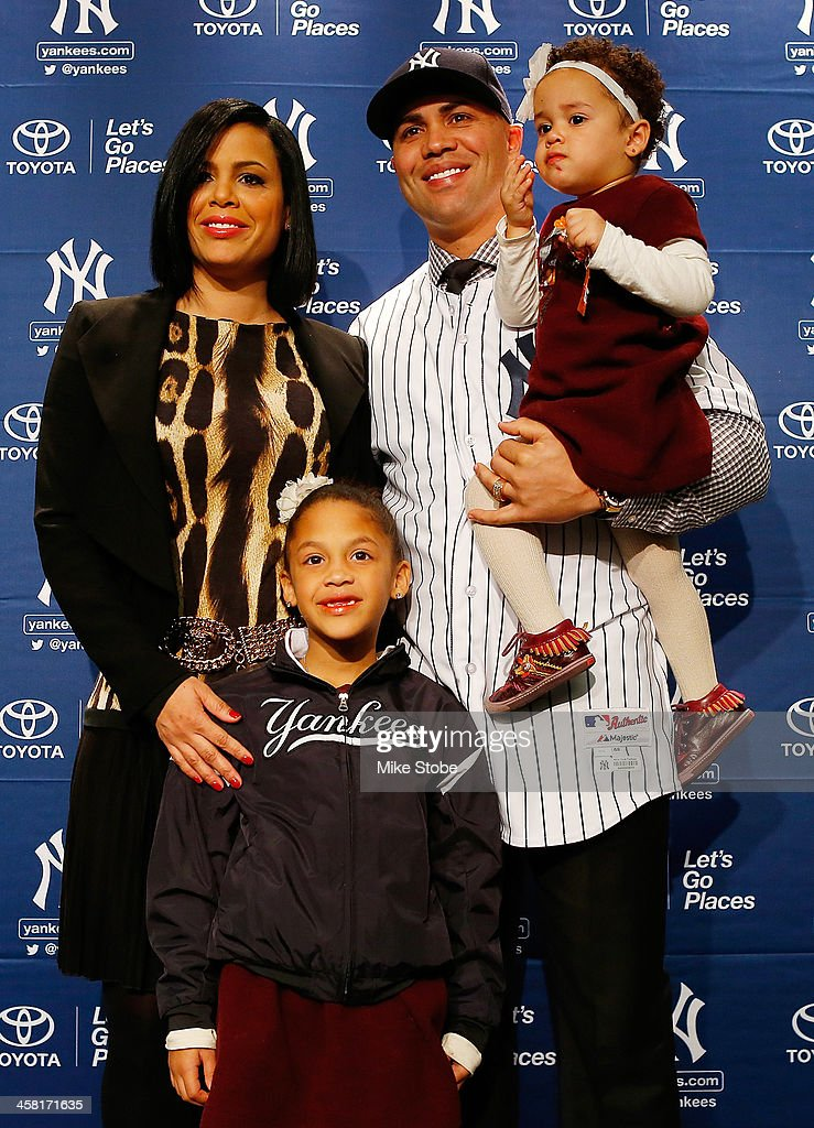 Jessica Beltran, Ivana Beltran, <a gi-track='captionPersonalityLinkClicked' href=/galleries/search?phrase=Carlos+Beltran&family=editorial&specificpeople=167108 ng-click='$event.stopPropagation()'>Carlos Beltran</a> and Kiara Beltran pose for a photo during Beltran's introductory press conference at Yankee Stadium on December 20, 2013 in the Bronx borough of New York City.