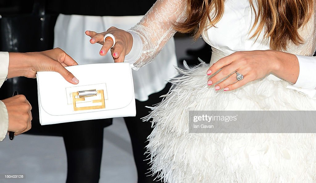 Jessica Biel (ring, purse detail) attends the 'Total Recall' UK premiere at Vue West End on August 16, 2012 in London, England.