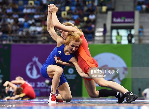 Jessica Blaszka of the Netherlands and Iwona Matkowska of Poland compete in the Women's wrestling 48kg Freestyle quarter final match during day three...