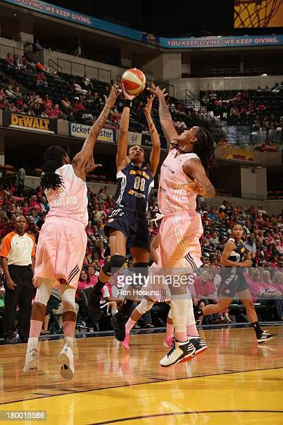 Jessica Breland and Erlana Larkins of the Indiana Fever battle Iziane Castro Marques of the Connecticut Sun on September 7 2013 at Bankers Life...