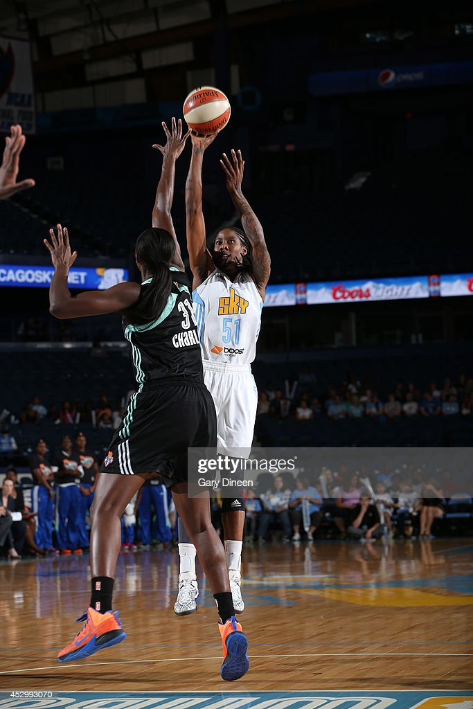 Jessica Breland #51 of the Chicago Sky shoots over Tina Charles #31 of the New York Liberty during the game on July 31, 2014 at Allstate Arena in Rosemont, Illinois.