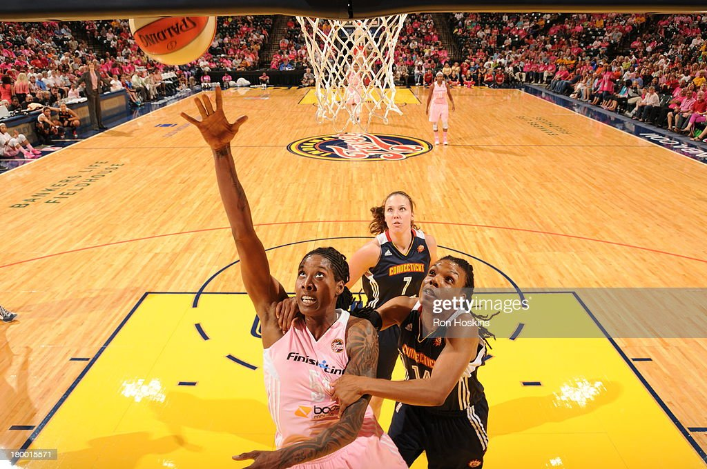 Jessica Breland of the Indiana Fever lays the ball up on Tan White of the Connecticut Sun on September 7 2013 at Bankers Life Fieldhouse in...