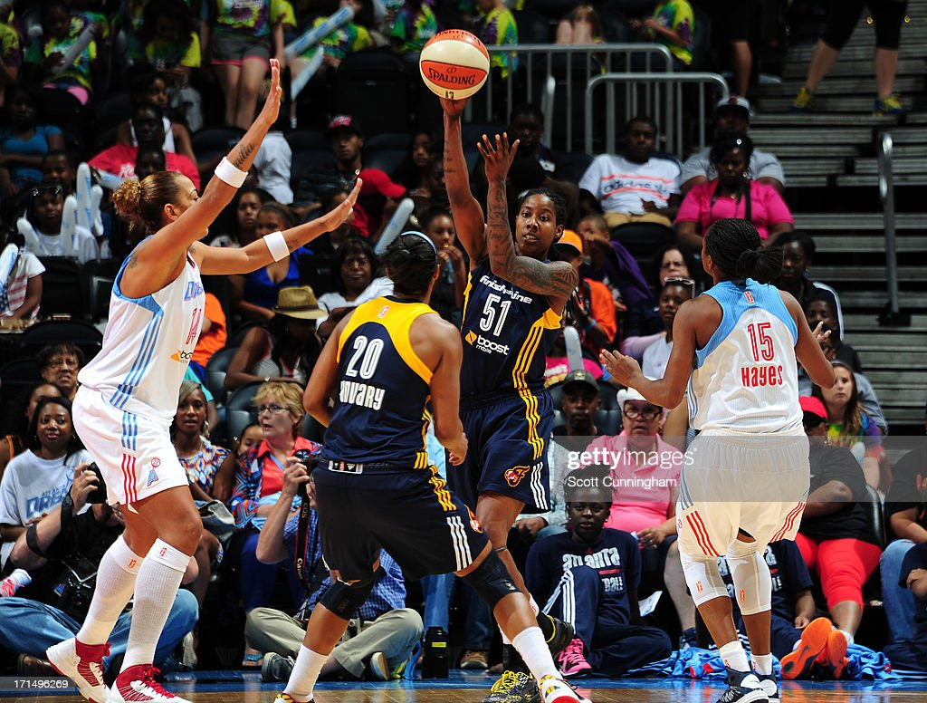 Jessica Breland #51 of the Indiana Fever passes the ball against the Atlanta Dream at Philips Arena on June 25, 2013 in Atlanta, Georgia.