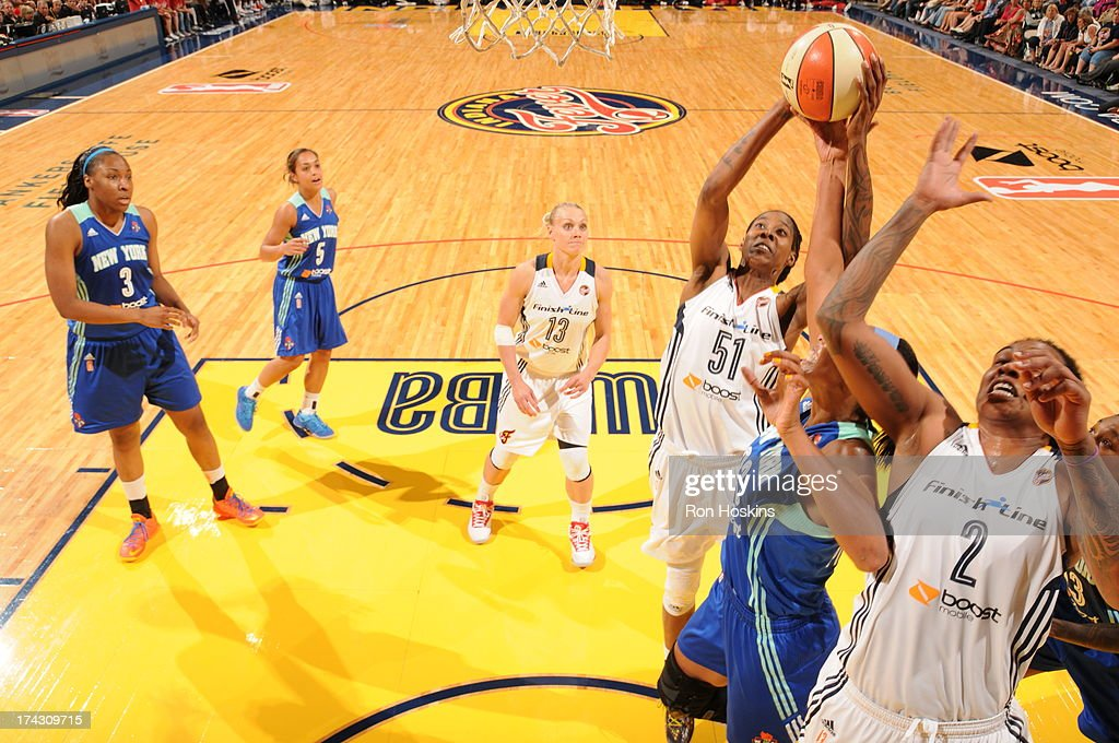 Jessica Breland #51 of the Indiana Fever shoots over a New York Liberty defender on July 23, 2013 at Bankers Life Fieldhouse in Indianapolis, Indiana.
