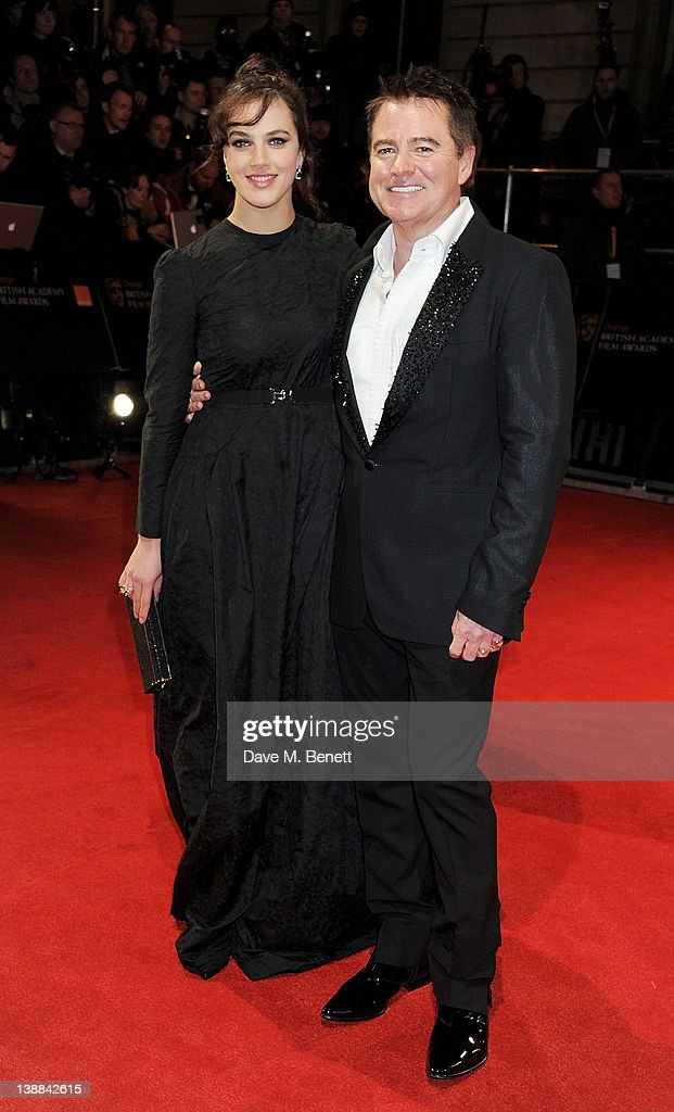Jessica Brown Findlay (L) arrives at the Orange British Academy Film Awards 2012 at The Royal Opera House on February 12, 2012 in London, England.