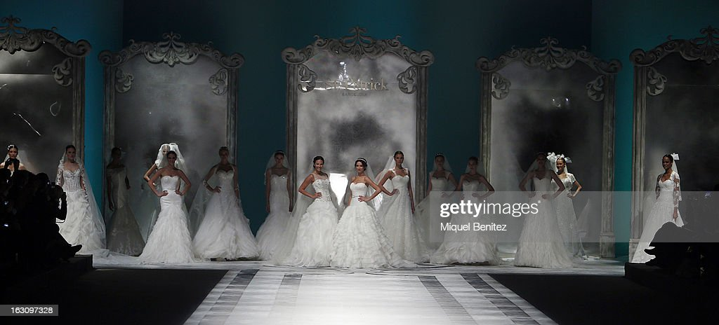 Jessica Bueno (centre L), Raquel Jimenez (centre R) and models walk the runway during the St Patrick new collection presentation on March 4, 2013 in Barcelona, Spain.