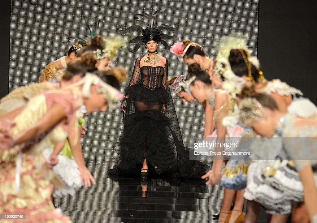 Jessica Bueno walks the runway during the International Flamenco Fashion Show 'SIMOF' on February 2, 2013 in Seville, Spain.