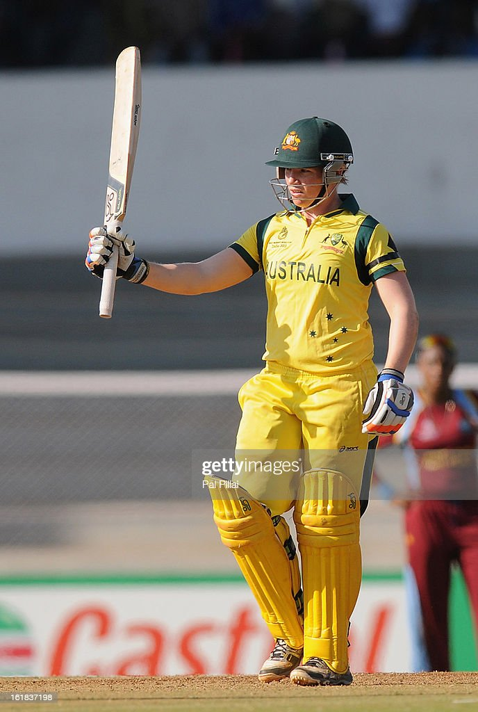 Jessica Cameron of Australia raises her bat after scoring a half century during the final between Australia and West Indies held at the CCI (Cricket Club of India) stadium on February 17, 2013 in Mumbai, India.