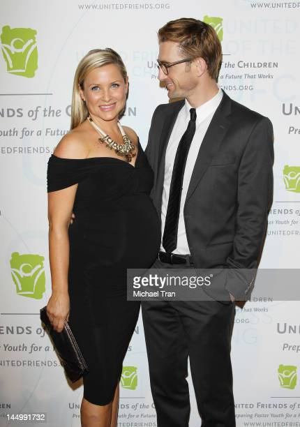 Jessica Capshaw and husband Christopher Gavigan arrive at United Friends of the Children Benefit held at The Beverly Hilton Hotel on May 21 2012 in...