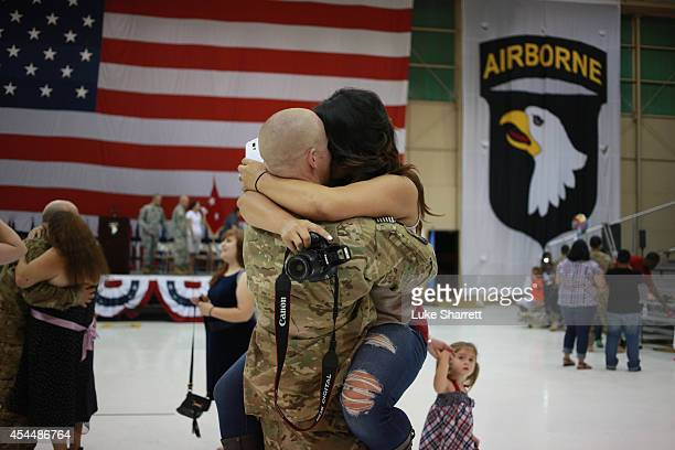 Jessica Carter embraces her husband Spc Josh Carter of the US Army's 159th Combat Aviation Brigade 101st Airborne Division following a homecoming...
