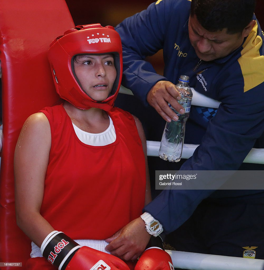 Jessica Centeno Centeno (red) of Ecuator rests during the Women's 51kg Boxing Qualifications as part of the I ODESUR South American Youth Games at Coliseo Miguel Grau on September 22, 2013 in Lima, Peru.