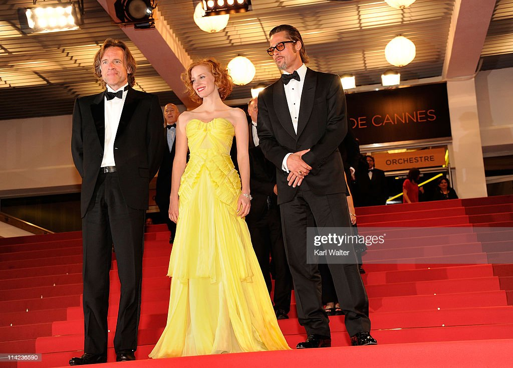 Jessica Chastain (C), and actor Brad Pitt (R) depart 'The Tree Of Life' premiere during the 64th Annual Cannes Film Festival at Palais des Festivals on May 16, 2011 in Cannes, France.
