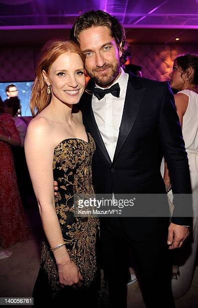 Jessica Chastain and Gerard Butler attend the 2012 Vanity Fair Oscar Party Hosted By Graydon Carter at Sunset Tower on February 26 2012 in West...