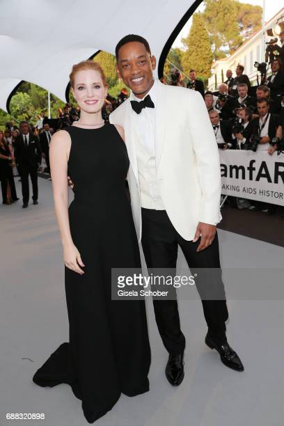 Jessica Chastain and Will Smith arrive at the amfAR Gala Cannes 2017 at Hotel du CapEdenRoc on May 25 2017 in Cap d'Antibes France