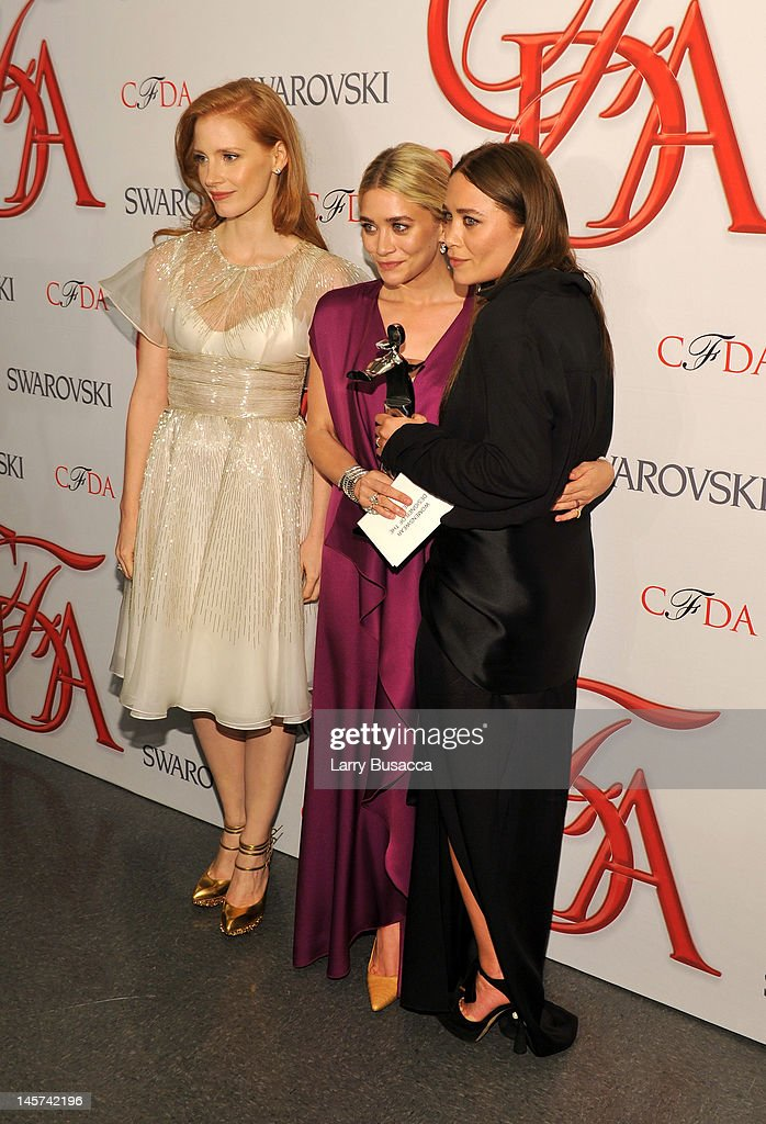 Jessica Chastain, Ashley Olsen and Mary-Kate Olsen attend the2012 CFDA Fashion Awards at Alice Tully Hall on June 4, 2012 in New York City.
