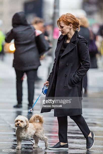 Jessica Chastain is seen walking her threelegged dog Chaplain on rainy afternoon on December 22 2015 in New York City