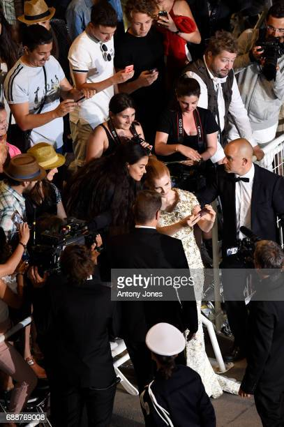 Jessica Chastain poses with fans as she attends the 'In The Fade ' screening during the 70th annual Cannes Film Festival at Palais des Festivals on...