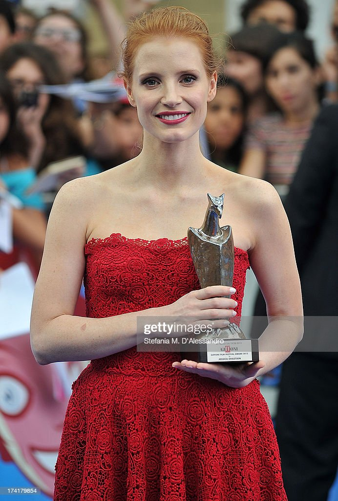 <a gi-track='captionPersonalityLinkClicked' href=/galleries/search?phrase=Jessica+Chastain&family=editorial&specificpeople=653192 ng-click='$event.stopPropagation()'>Jessica Chastain</a> poses with the 2013 Giffoni award on July 21, 2013 in Giffoni Valle Piana, Italy.