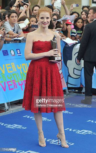 Jessica Chastain poses with the 2013 Giffoni award on July 21 2013 in Giffoni Valle Piana Italy