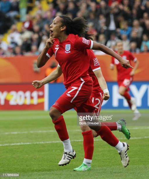 Jessica Clarke of England celebrates after scoring her team's 2nd goal wth her team mate Karen Carney during the FIFA Women's World Cup Group B match...