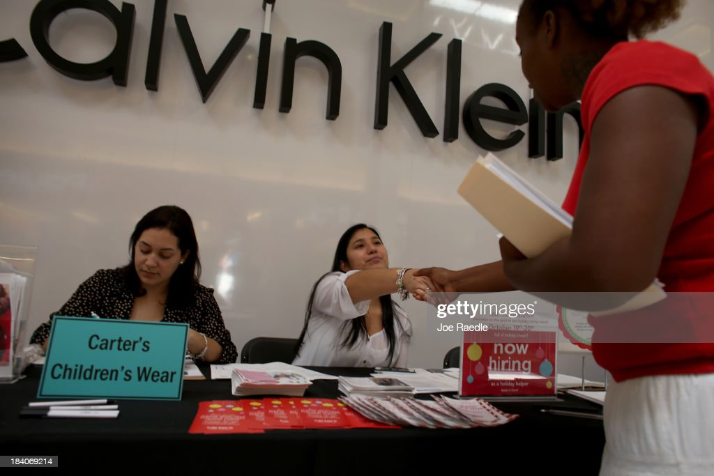 Jessica Cortes (L) and Scarlett Ramirez recruit people for work at Carter's Children's Wear during a job fair at Sawgrass Mills on October 11, 2013 in Sunrise, Florida. As the holiday season approaches many of the roughly 50 retailers at the job fair including Banana Republic, J.Crew Factory, Victoria's Secret and Calvin Klein are starting to hire people for seasonal work as well as continuing to look for qualified full time employees.