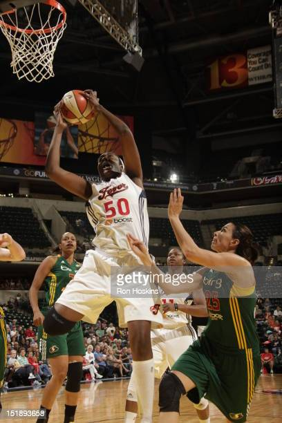 Jessica Davenport of the Indiana Fever battles Svetlana Abrosimova of the Seattle Storm at Banker's Life Fieldhouse on September 12 2012 in...
