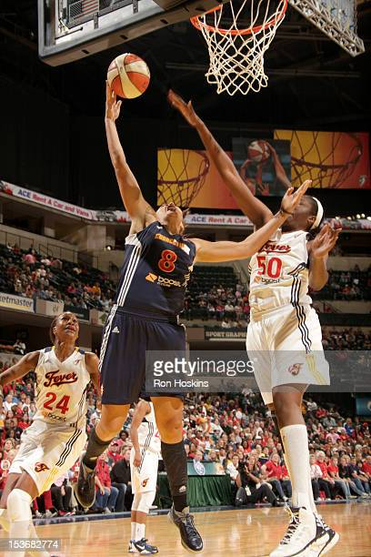 Jessica Davenport of the Indiana Fever defends against Mistie Mims of the Connecticut Sun in Game Two of the East Conference WNBA Finals at Banker's...