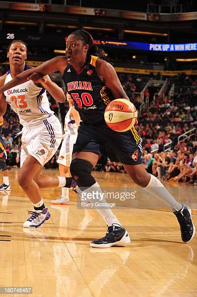 Jessica Davenport of the Indiana Fever drives against Avery Warley of the Phoenix Mercury on August 25 2012 at US Airways Center in Phoenix Arizona...
