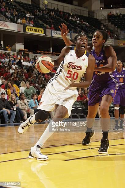Jessica Davenport of the Indiana Fever drives on Krystal Thomas of the Phoenix Mercury at Banker's Life Fieldhouse on September 9 2012 in...