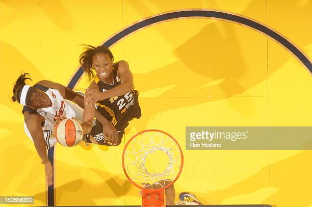 Jessica Davenport of the Indiana Fever goes for a rebound against Glory Johnson of the Tulsa Shock at Banker's Life Fieldhouse on September 23 2012...