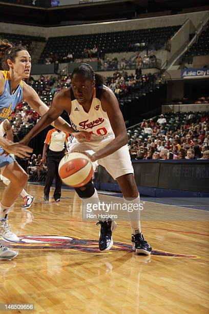 Jessica Davenport of the Indiana Fever handles the ball against Ruth Riley of the Chicago Sky at Banker Life Fieldhouse on June 16 2012 in...