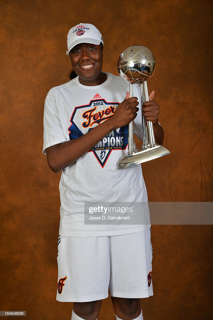 Jessica Davenport #50 of the Indiana Fever poses for portraits with the Championship Trophy after Game four of the 2012 WNBA Finals on October 21, 2012 at Bankers Life Fieldhouse in Indianapolis, Indiana.