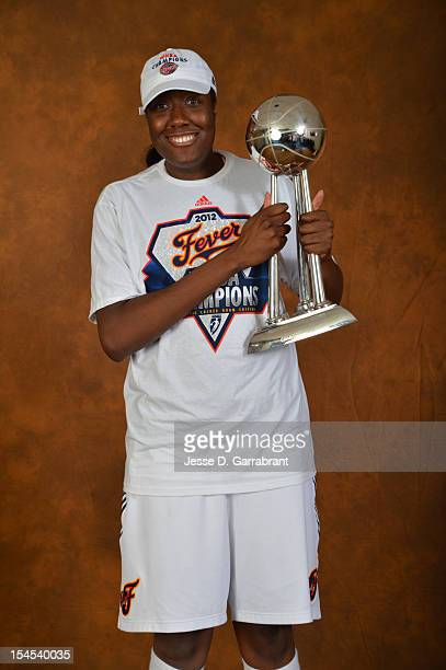 Jessica Davenport of the Indiana Fever poses for portraits with the Championship Trophy after Game four of the 2012 WNBA Finals on October 21 2012 at...