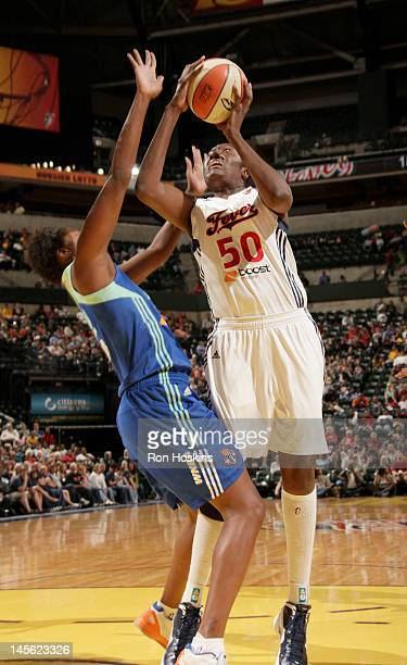 Jessica Davenport of the Indiana Fever shoots over a New York Liberty defender at Banker Life Fieldhouse on June 2 2012 in Indianapolis Indiana NOTE...