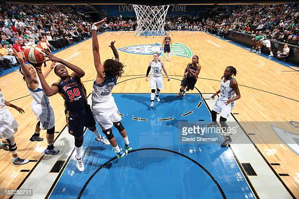 Jessica Davenport of the Indiana Fever shoots the ball against Seimone Augustus and Maya Moore of the Minnesota Lynx during the WNBA game on...