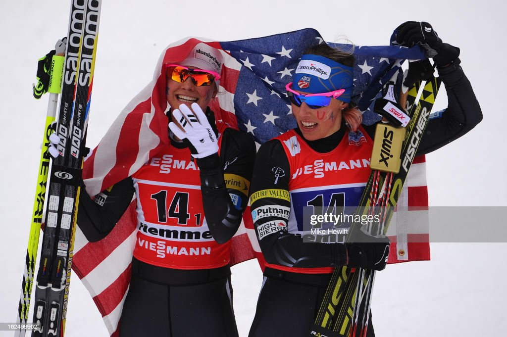Jessica Diggins (L) and Kikkan Randall of the United States celebrate victory in the Women's Team Sprint Final at the FIS Nordic World Ski Championships on February 24, 2013 in Val di Fiemme, Italy.
