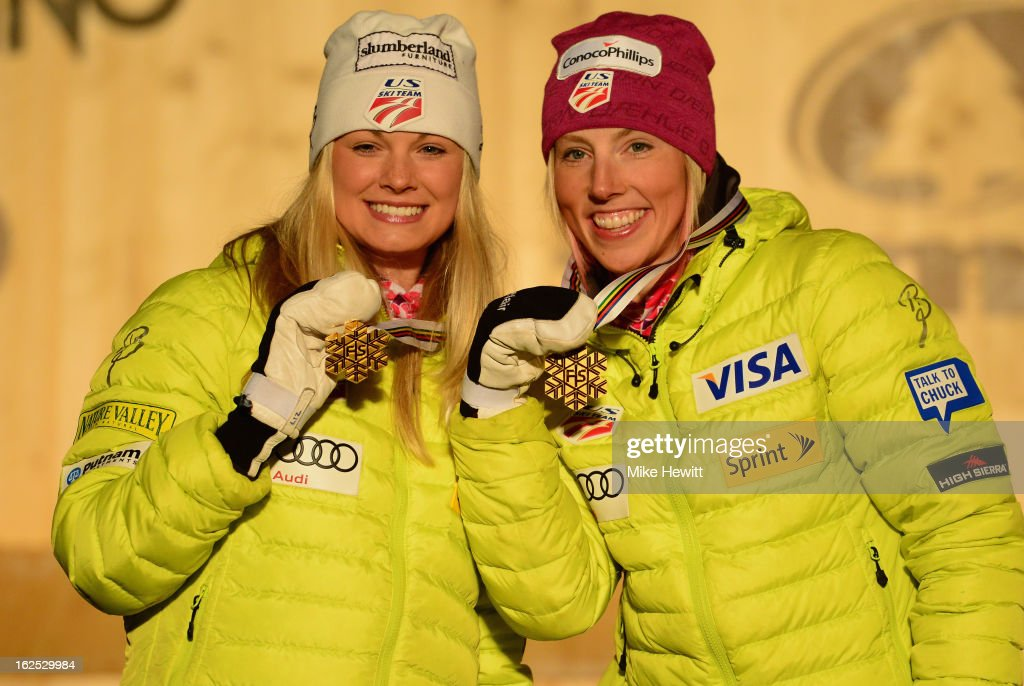 Jessica Diggins (L) and Kikkan Randall of the United States celebrate with their Gold medals on the podium at the medal ceremony for the Women's Team Sprint Final at the FIS Nordic World Ski Championships on February 24, 2013 in Val di Fiemme, Italy.